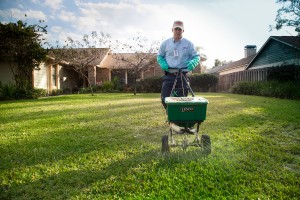 Apex Pest Control technician performing lawn care