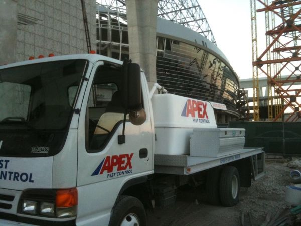 Apex Pest Control truck parked outside of Miami Marlins stadium
